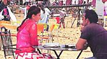 Kareena Kapoor Khan and Ajay Devgn take a breather in between shots