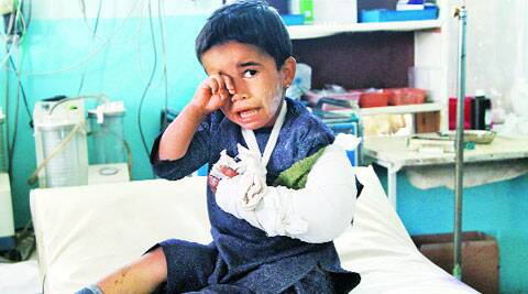 An injured boy sits on a bed following an attack, at a hospital in Ghazni city, Afghanistan. ( Source: AP )