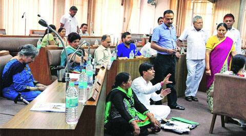 BJP councillor Saurav Joshi sitting on the floor during the MC House meeting on Monday.