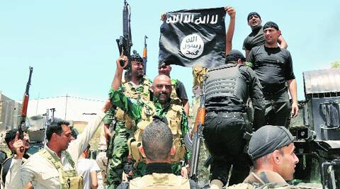 Iraqi security forces pull down a flag belonging to ISIS in Diyala province on Wednesday. ( Source: Reuters )