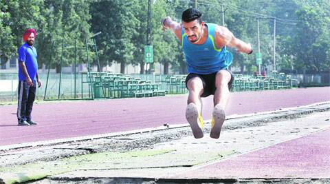 Triple jumper Arpinder Singh, watched by coach SS Pannu, during training in Patiala. The 21-year-old's coach will not be travelling with him to Glasgow. (Express photo by: Jasbir Malhi)
