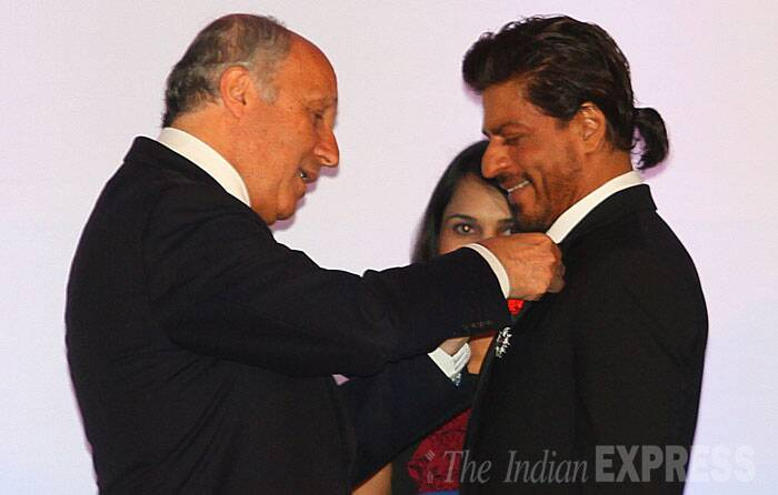 Bollywood Baadshah Shah Rukh Khan was conferred with top French civilian award — 'Knight of the Legion of Honor' at a prestigious event on Tuesday (July 1) in Mumbai. (Source: Express photo by Amit Chakravarty)
