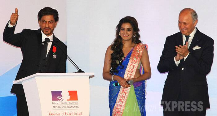 """It makes me feel proud to be recognised for the field I am passionate about. This award has motivated me to take Indian cinema to the next level of acceptance, love and glory. I thank the President of France for this honour,"" added the superstar. Seen here, Shah Rukh is all smiles as he takes the mic. (Source: Express photo by Amit Chakravarty)"