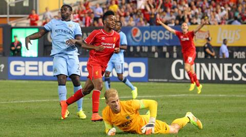 Liverpool FC forward Raheem Sterling (31) scores a goal in front of Manchester City FC defender Micah Richards (2) and goalkeeper Joe Hart (1) (Source: USA Today Sports)