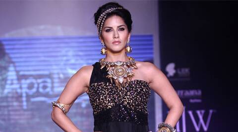 Sunny stole the show as she sashayed down the ramp wearing a Hasli with Victorian elements and gold claws.