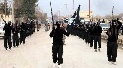 Fighters from the al-Qaida linked Islamic State of Iraq and the Levant (ISIL) marching in Raqqa, Syria. (Source: AP)