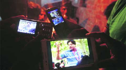 Locals watch a video of Tapas Paul's speech at Choumuha village on Monday. ( Source: Express photo by Subham Dutta )