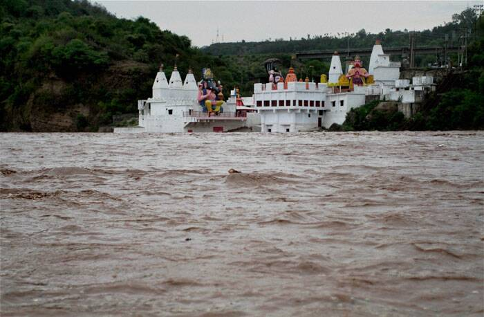A view of Har Ki Pauri near the banks of swollen Tawi Rivers following flash floods on the outskirts of Jammu on Thursday. (Source: PTI)