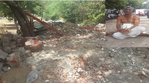 The temple priest (inset) who is sitting on a fast near the demolished site claimed that there was no prior notice or information by the municipal authorities.
