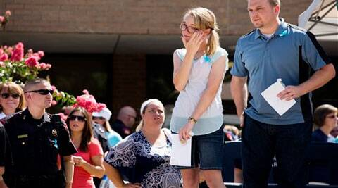 Cassidy Stay, second from right, the lone survivor of a family massacre in Texas, wipes her eye during a community memorial at Lemm Elementary School. (Source: AP)