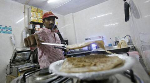 An inmate prepares food inside the kitchen of a restaurant run by the Tihar Jail authorities on Jail Road in west Delh