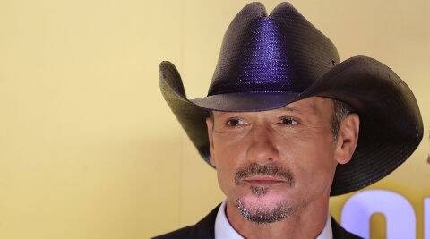 A woman hit Tim McGraw twice in the video and the 47-year-old singer retaliated with a slap. (Source: Reuters)
