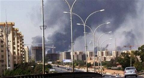 In this image made from video by The AP, smoke rises from the direction of Tripoli airport in Tripoli, Libya, Sunday. (AP Photo)