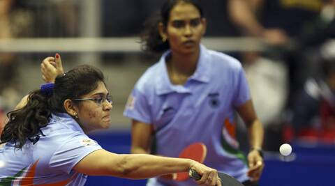 India's Madhurika Sushas Patkar, and Shamini Kumaresan serve to New Zealand's Yang Sun and Karen Li during their women's doubles table tennis quarterfinal match at the Glasgow 2014 games. (Source: AP)