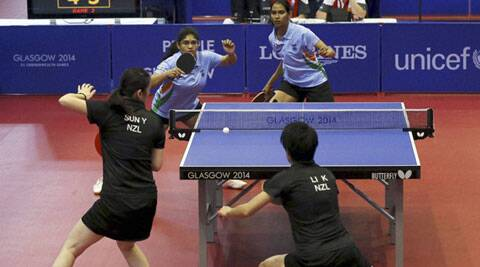 India's Madhurika Sushas Patkar, facing left, and Shamini Kumaresan serve to New Zealand's Yang Sun, left, and Karen Li during their women's doubles table tennis quarterfinal match at the Scotstoun sports center in Glasgow. (Source: AP)