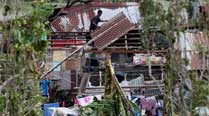 Typhoon kills 38 in Philippines, spares Manila