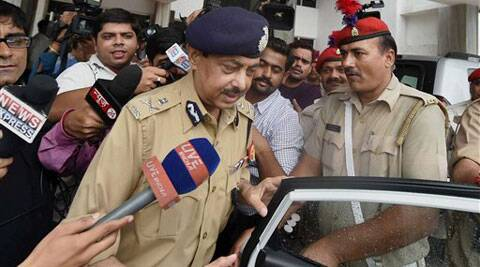Uttar Pradesh DGP A L Banerjee comes out of the annexe after meeting Chief Minister Akhilesh Yadav about the gruesome rape and murder of a woman in Mohanlalganj area in Lucknow on Friday. (Source: PTI)