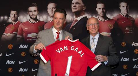 Manchester United's new manager Louis van Gaal, left, poses for pictures with former player Bobby Charlton before a press conference at Old Trafford (Source: AP)
