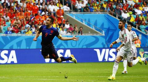 Netherlands' Robin van Persie puts the first nail in the Spanish coffin. (Source: Reuters)