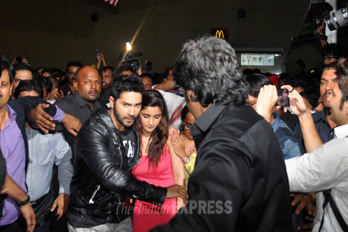 Varun Dhawan helps Alia Bhatt get past the crowd. (Source: Varinder Chawla)