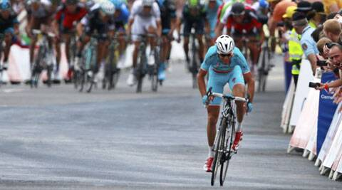 Italy's Vincenzo Nibali, front, crosses the finish line ahead of the sprinting pack, rear, to win the second stage of the Tour de France cycling race over 201 kilometers (124.9 miles) with start in York and finish in Sheffield (Source: AP)