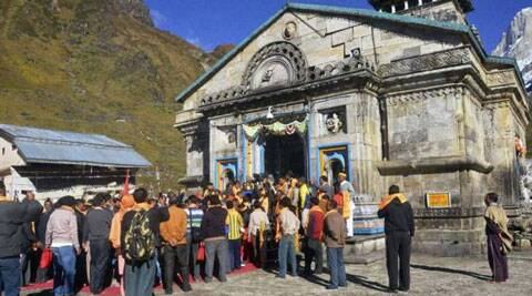 The Badrinath highway is blocked since last evening at Lambagad and Border Roads Organisation and personnel are busy clearing the road. (Source: PTI photo)