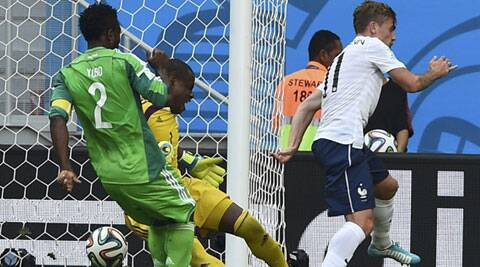 Nigeria's Joseph Yobo kicks the ball and scores an own goal against France. (Source: Reuters)