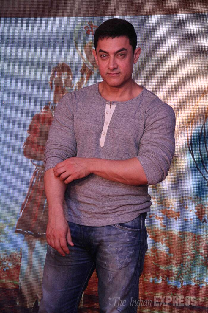 Aamir Khan looked fit and fab in a grey T-shirt with denims. (Source: Express Photo by Amit Chakravarty)
