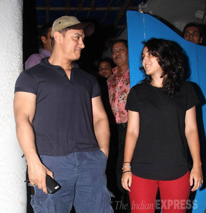 So sweet! Dad Aamir Khan and daughter Ira exchange smiles as the cameras snap away. (Source: Varinder Chawla)