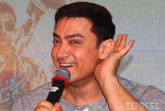 Bollywood superstar Aamir Khan, who plays the lead in upcoming film 'PK',  launched the second poster of the film at an event in Mumbai on Wednesday (August 20). The actor seemed keen to hear the reactions of the media to his new poster.  (Source: Express Photo by Amit Chakravarty)