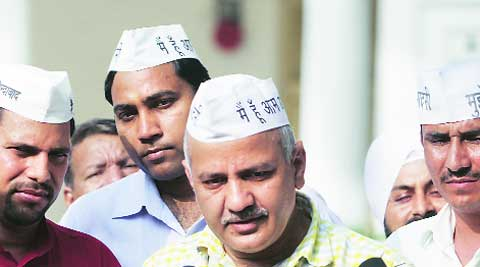 (From left) AAP MLAs Sanjeev Jha (Burari), Manoj Kumar (Kondli), Manish Sisodia (Patparganj) and Surinder Singh (Delhi Cantt) at Vidhan Sabha on Friday. (Amit  Mehra)