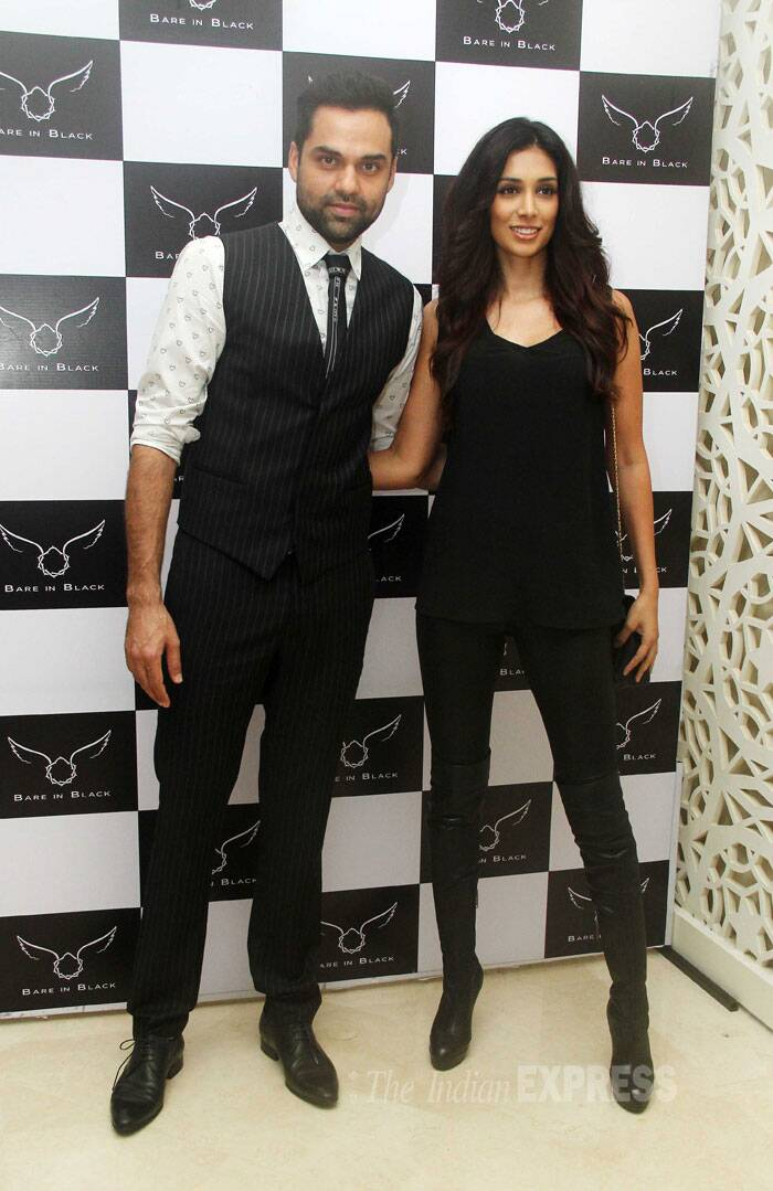 Couple Abhay Deol and Preeti Desai were colour coordinated in black and white. (Source: Varinder Chawla)