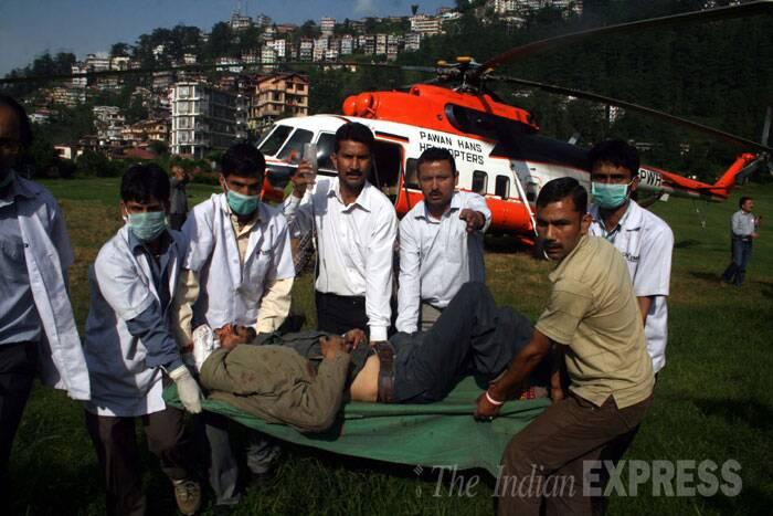 An injured man is being brought by doctors in Shimla. (Source: Express photo by Lalit Kumar)
