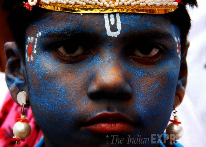 From this week, our National Photo Editor Neeraj Priyadarshi will pick the best photos of the past seven days. Here is the first of the series. <br /> A boy is seen with painted blue face and dressed as Shri Krishna at Dahi Handi Celebrations at Dadar, Mumbai. (Source: Express photo by Amit Chakravarty)