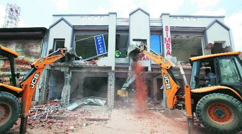 The civic body workers carry out the demolition of shopping complex in Jamalpur area of Ahmedabad on Tuesday. (Express photo by Javed  Raja)