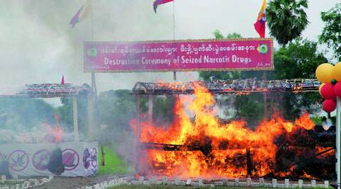 In Myanmar, source of the narcotic, a seized consignment of methamphetamine is set on fire. ( Source: AP )