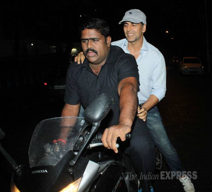 Akshay takes a bike ride with one of his staff members. (Source: Varinder Chawla)