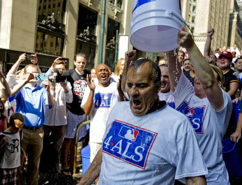 Major League Baseball Executive Vice President of Baseball Operations Joe Torre participates in the ALS Ice-Bucket Challenge outside the organization's headquarters in New York. (Source: AP)