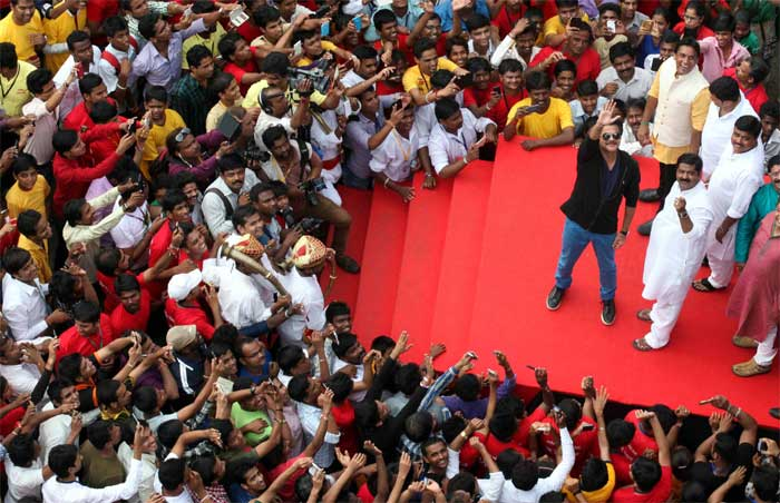 Bollywood actor Anil Kapoor waves to his fans as he attends the 'Dahi Handi' programme during the Janamashtami celebrations at Ghatkopar in Mumbai. (Source: Express Photo by Pradip Das)