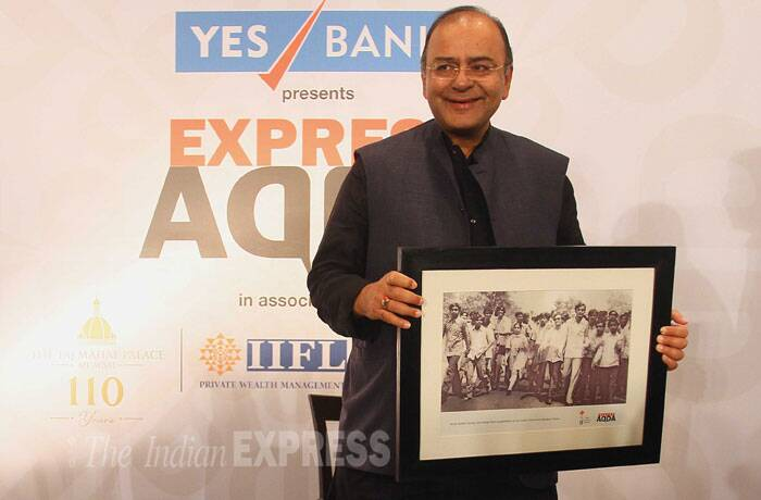 Arun Jaitley displays a memento presented to him at Express Adda. (Source: Express photo by Amit Chakravarty)