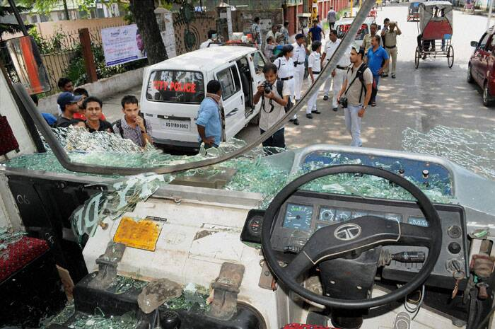 An ASTC bus that was damaged by protesters during 12-hour Assam bandh in Guwahati on Thursday. (Source: PTI)