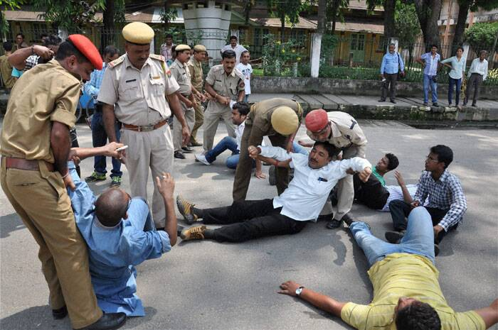 Security personnel detain AGP activists during the 12 hour Assam bandh in Guwahati on Thursday. <br /> The bandh was called in protest against police action which allegedly led to the killing of three people in Golaghat town along the border with Nagaland. (Source: PTI)