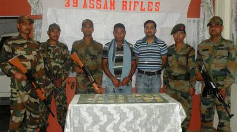 Troops from the 39th Assam Rifles with seized money in Mizoram's Kolasib district on Friday night.