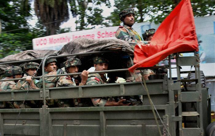 Army personnel carrying out a flag march during the curfew in Golaghat town on Thursday following violent clashes over Assam-Nagaland border conflict. (Source: PTI)
