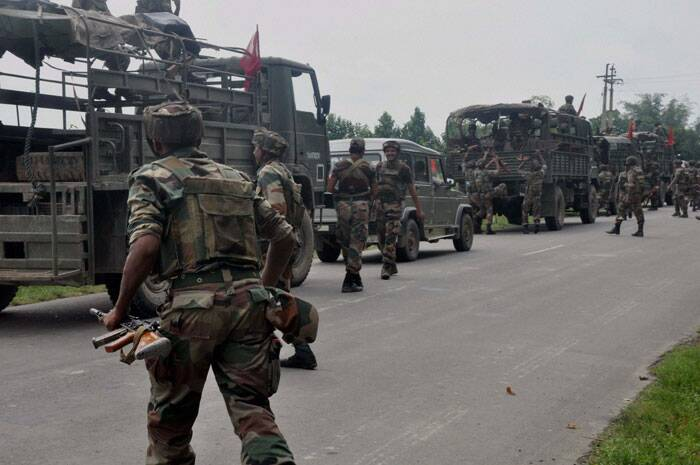 Army personnel arrive during the curfew in Golaghat town on Thursday following violent clashes over Assam-Nagaland border conflict. (Source: PTI)