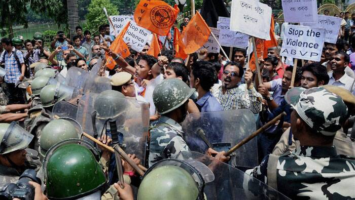 Security personnel try to stop activists of Akhil Bharatiya Vidyarthi Parishad (ABVP) during the 12 hour Assam bandh in Guwahati on Thursday. (Source: PTI)