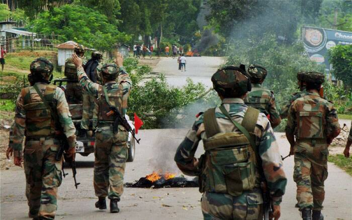 Army soldiers in action following violent protests at Telgaram Numaligarh in tension-gripped Golagaht district on Thursday. (Source: PTI)