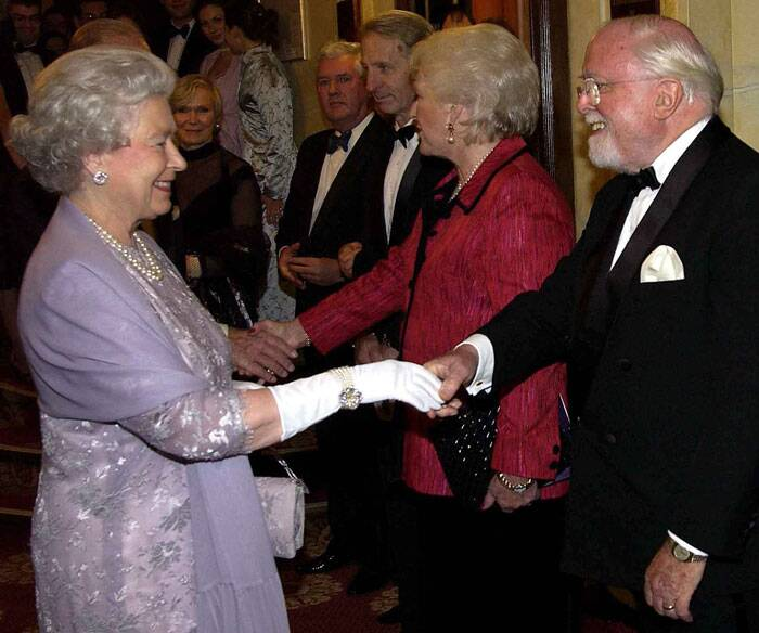 "Britain's Queen Elizabeth meets Sir Richard Attenborough and his wife at a gala performance of ""The Mousetrap"" in London, in this 2002 file picture. (Source: Reuters)"