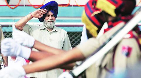 Punjab Assembly speaker Charanjit Singh Atwal takes the salute as part of Independence Day celebrations at Guru Nanak Stadium in Ludhiana on Friday. (Source: Express photo by Gurmeet Singh)