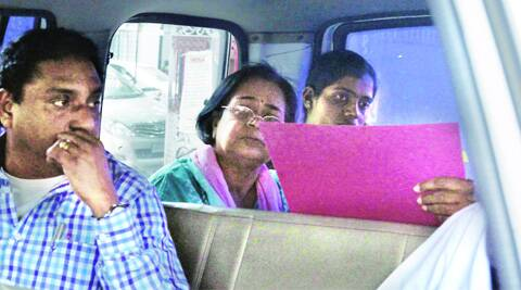 Chhabi Bardhan (centre) was produced in a special court on Thursday. (Source: Express photo)